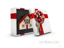 Model of a house in gift box with red ribbon, 3d Illustration.  Stock Photography