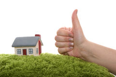 Model of house with hand as ok symbol. Model of a  house with hand as ok symbol Royalty Free Stock Image