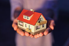 Model of house  on hands Royalty Free Stock Image