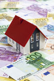 Model house on heap of euro notes Royalty Free Stock Photography