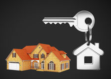 Model house and keys. Key with keychain and model cottage Stock Photo