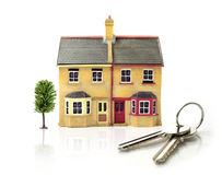 Model House with keys. Studio image of modest 'first-time buyer' dwellings with white space, soft reflections and keys. Ideal for real estate, mortgage and home royalty free stock photos