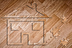 Model of the house on the laminate. And pieces of the puzzle royalty free stock images