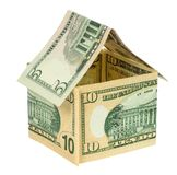 Model house made from dollar banknotes. Isolated on white background with clipping path Royalty Free Stock Images