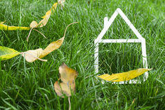 Model house made on green grass Stock Photo