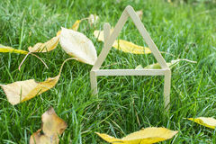 Model house made on green grass Royalty Free Stock Image