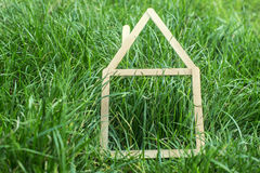 Model house made on green grass Royalty Free Stock Photos