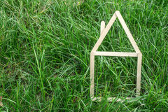 Model house made on green grass Royalty Free Stock Photo