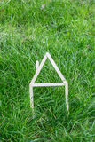 Model house made on green grass Stock Image
