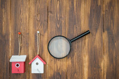 Model house with Magnifying Glass, House hunting Stock Images