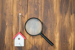 Model house with Magnifying Glass, House hunting Royalty Free Stock Images
