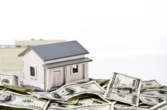 Model house with money Royalty Free Stock Photography
