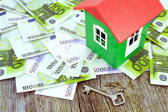Model of house on money. Image of a model house standing on Euro banknotes Royalty Free Stock Photos