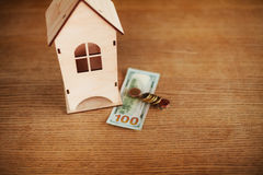 Model of house with money on the table Royalty Free Stock Photo