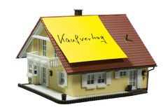 Model house with note purchase agreement Royalty Free Stock Image