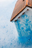 Model house and painting brush in foamy water Royalty Free Stock Image
