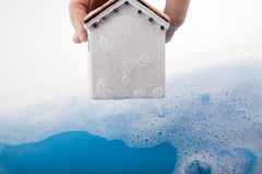 Model house and painting brush in foamy water Royalty Free Stock Photos