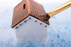 Model house and painting brush in foamy water Royalty Free Stock Photo