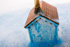 Model house and painting brush in foamy water Royalty Free Stock Images