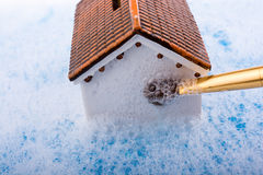 Model house and painting brush in foamy water Stock Image