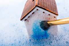 Model house and painting brush in foamy water Stock Photography