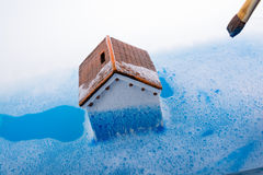 Model house and painting brush in foamy water Stock Photos