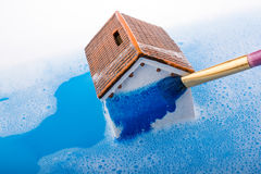 Model house and painting brush in foamy water Royalty Free Stock Photography
