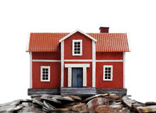 Model of house on pile of coins Royalty Free Stock Photography