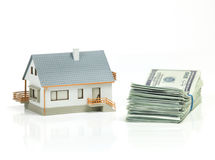 House and stack of dollars Royalty Free Stock Photography