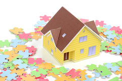 Model house and puzzle Royalty Free Stock Photo