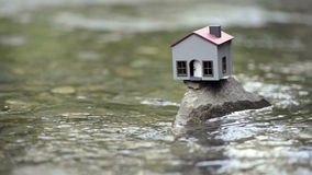 Model house in the river stock footage