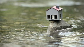 Model house in the river stock video footage