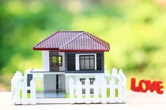 Model house and symbols stock images