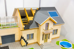 Model of house, thermal insulation of roof concept. Energy and money saving materials and systems royalty free stock photos