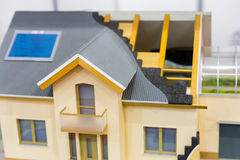 Model of house, thermal insulation of roof concept. Energy and money saving materials and systems stock photo
