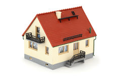 Model house with tiled roof. Isolated