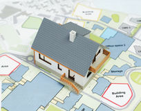 Model House on top Architectural Plans - Stock Image Stock Photo