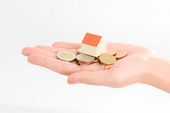 Model house on top of money pile suggesting savings for a house Royalty Free Stock Photo