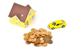 Model house and toy car with coins Royalty Free Stock Images