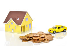 Model house and toy car with coins Royalty Free Stock Photo