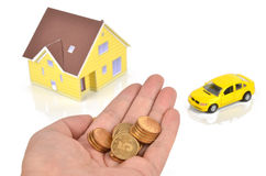 Model house and toy car with coins Stock Photos