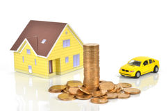 Model house and toy car with coins Royalty Free Stock Photos