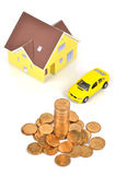 Model house and toy car with coins Stock Photography