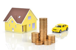 Model house and toy car with coins Stock Photo