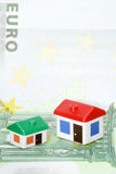 Model houses on euro banknote. Usable in projects related to mortgage or investing on real estate property Stock Images