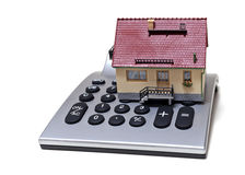 Model huis en calculator Royalty-vrije Stock Foto's