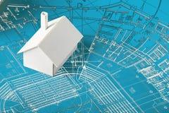Model huis op blauwdrukken Stock Foto