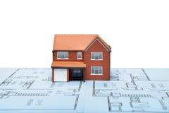 Model huis op blauwdrukken royalty-vrije stock foto's