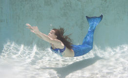 Free Model In A Pool Wearing A Mermaid`s Tail. Stock Photo - 99231430