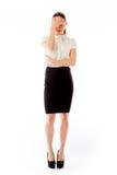 Model isolated on plain background ashamed hiding Royalty Free Stock Photo